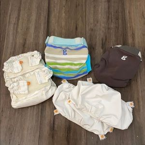 G diaper   two newborn and two small diapers